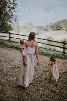 Mom and two adorable girls. The tie shoulder straps are so pretty and convenient for adjusting to different people.