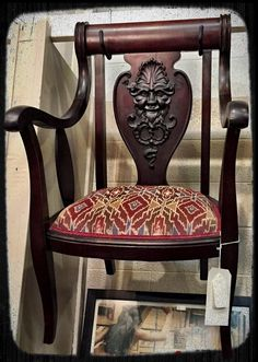 Mahogany arm chair, with carving of North Wind, $110.  Gaslamp Antiques Too, booth T293.