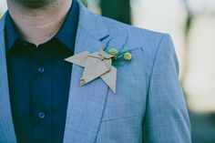 folded paper + billy button boutonniere // photo by Lad & Lass // http://ruffledblog.com/intimate-south-african-wedding