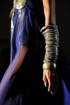 Major arm bling. Amusingly, those giant bracelets are spiral steel boning. Clever seamstress....