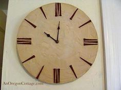 Rustic Wall Clock -- made with particle board round, tile grout for texture, square head nails, and clock works...oh and paint for the nails so they would be a rustic color