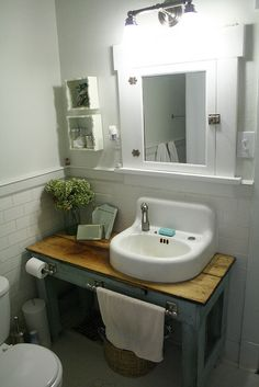 Ok.  I have an old sink like this - instead of replacing it, I could simply replace the faucet and build the table around it.  Like!