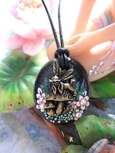 Mushroom Fairy Surrounded With Pink Flowers Necklace Faerie Fae Fantasy Mystical Realm Nature Stone Flowers Jewelry Fairytale Storybook. $29.00, via Etsy.