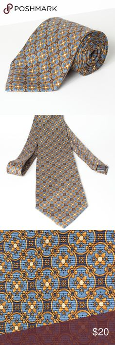 "Robert Talbott Men's Necktie Multi-Color Robert Talbott Men's Necktie Gold & Blue Multi Color Geometric Silk Made in USA  Measurements  Width at widest point: 3.75""  Length: 59""  Excellent condition with no holes or stains. Come from smoke/pet free home! Robert Talbott Accessories Ties"