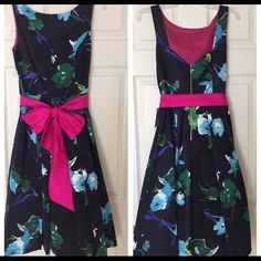 "NWT Eliza J Floral with Pink Sash Dark Blue Dress. NWT Eliza J Floral Dark Blue with Bright Pink Sash Midi Dress.  Size: 8  Measurements:  18 Chest 15"" Waist  40"" Length     No trade, no holding, no off sight payment Eliza J Dresses Midi"