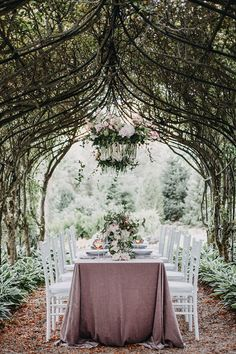 Garden Arbor Wedding Reception with a Floral Chandelier #rosé #wedding #weddings #weddingideas #french #garden #weddingeditorial #styledshoot #weddingreception #weddingflowers #reception