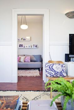 A view into a small living room from a larger living room