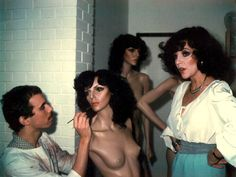 Joan Collins posing for her Adel Rootstein mannequin, Chelsea, London. 1979. Make-up artist is Andrew Shaw.