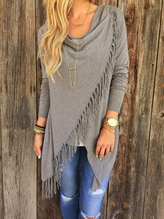 The Olivia Fringe Shawl is a beautiful classic soft cardigan, that is lightweight and perfect for any time of year! Asymmetrical hem with fringe. Long sleeves. Unlined. Available in White, Gray Or Bla