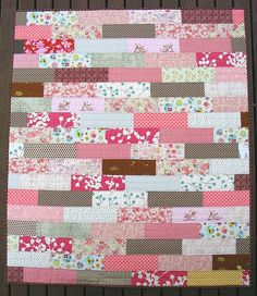 Baby Girl quilt. This would be ubber easy with one of those jelly roll things!
