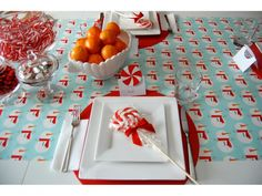 """Keep it Kid Friendly - You won't be afraid to welcome the kids to the table -- or create a separate kids table altogether -- with a tabletop setup that they can spill on all they like: Use wrapping paper as a low cost, festive runner that you can crumple up and recycle after the meal. """"Keep the tabletop affordable and totally kid friendly by using wrapping paper as a no-fuss runner,""""     For a similar look, get it now: Holiday Owls Wrapping Paper, $7.95 at Paper Source"""