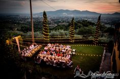 Scenic lighting to frame a Tuscan panorama for a rustic chic Tuscan wedding