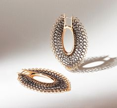 GianCarlo Montebello Earrings: Softness ellisse, 2009 structure and outline in 18 carat yellow gold, fire burnished stainless steel chain mail from Bradamante