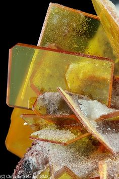 Wulfenite Photo Copyright © Chinellato Matteo - This image is copyrighted. Unauthorized reproduction prohibited. Locality: Rowley Mine (Rawley Mine; Reliance Mine; Reliance Copper Mine; Rainbow Mine; Theba Mine; San Carlos patented claim #4524), Theba, Painted Rock District, Painted Rock Mts, Maricopa Co., Arizona, USA Nice 7.1 mm group of orange-yellow light Wulfenite. Collection & Photo M.Chinellato