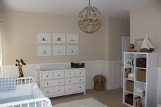 A beige and white neutral nursery for a baby boy with accents of blue and a bit of ruggedness throughout.
