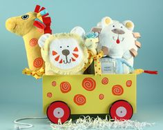 Giraffe plush & wood wagon filled with layette items made by Silly Phillie®