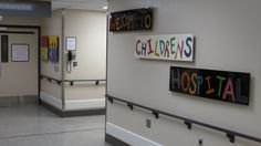 This cheery and playful sign welcomes visitors to this pediatric wing.
