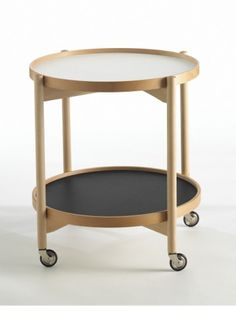 Caster Table with reversible and removable trays.