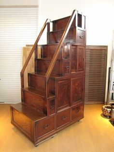 I soooo love this step tansu!!!  These are also universally placable because the drawers and cabinets open from either side.   This one cost approx $19,000 - $20,000 depending on the exchange rate...