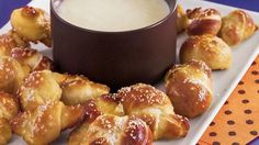 Twisted Pretzel Bites-Pillsbury® classic pizza crust provides a simple addition to these warm pretzel bites served with queso dip – perfect appetizers for a crowd.