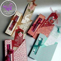 Kleine Weihnachtsgeschenke mit vier Teelichtern