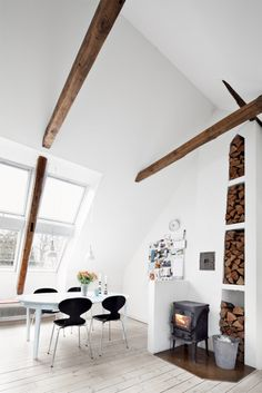 I love the cuts in the wall to hold firewood, what a great rustic look and practical for a real fireplace