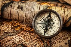 Old vintage compass on ancient map. Travel geography navigation concept background - old vintage retro compass on ancient world map.
