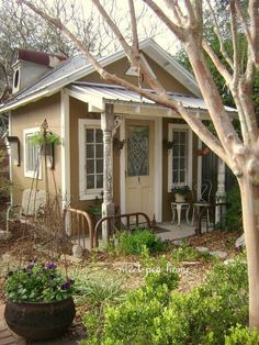 A cute little cottage or she shed. This would make a wonderful painting studio or backyard office space.