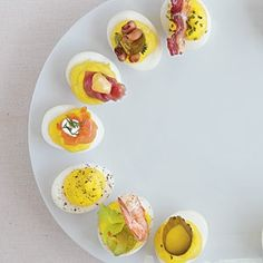Deviled eggs are an easy snack you can make with your kids...put out pickles, herbs and cured meats for them to top with for a great DIY snack time.