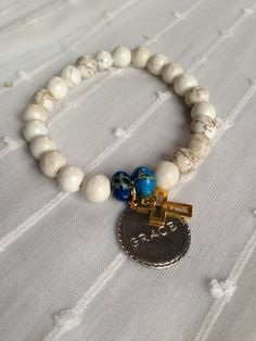 Holland's Trinkets || hand stamped Grace on silver with gold cross and magnesite beads. Gold Cross, Hand Stamped, Beaded Bracelets, Couture, Beads, My Style, Silver, Gifts, Jewelry
