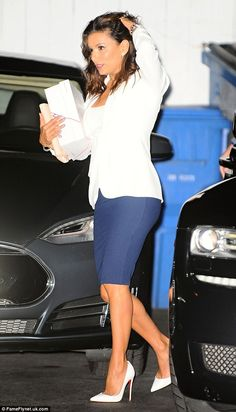 Stunning: The  starlet dazzled in a chic navy blue pencil skirt paired with a white blazer...