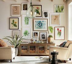 Gorgeous arrangement of art over a console