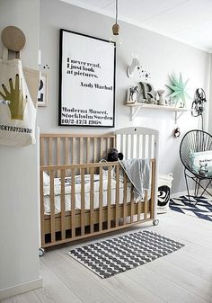 Warm grey modern nursery with wood crib and black acapulco chair