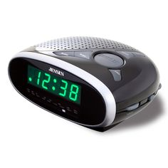 """Jensen AM/FM Dual Alarm Clock Radio. This AM/FM alarm clock radio has a bright 0.6"""""""" Green LED display. Wake to radio or alarm. Connect your iPod shuffle, MP3 or other digital audio players to the auxiliary line-in jack and listen to your personal collection of music.* 0.6"""""""" Green LED Display * AM/FM Receiver * Wake to Radio or Alarm * Sleep * Snooze * Power: AC 120V/60Hz Battery Back-up for Clock: 1 x 9V (006P) (Not included) * Size: 2-3/4""""""""(H) x 6-1/8""""""""(W) x 5""""""""(D)"""