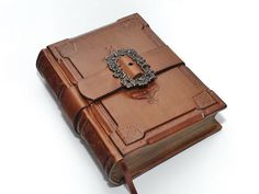 Emeralds journal. Given to her by Legolas.  {A knights journal handmade brown leather  journal   by dragosh, $135.00}