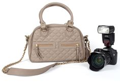 pretty camera bag for girls.  seriously, it has divided pockets for camera, lens, etc.