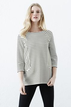 This on-trend stripe top is constructed from jersey and features a round neck, cropped sleeves, zip details and all-over stripe print. Height of model shown: 5ft 10 inches/178cm. Model wears: UK size 10.