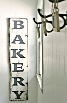 AVAILABLE IN LIMITED QUANTITIES!   This Fixer Upper Inspired hand painted Bakery Sign is 12 x 60. This vertical sign is painted in the