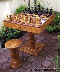 A Stunning Solid Teak Chess Table With Chess Board, Drawers And Two Stools.  This Fine Piece Of Furniture Will Be The Focus Of Any Room.