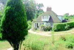 Self Catering Holidays - Miles and Son Holiday in Swanage - Cliff End in Studland - Character house in unrivalled position - sheltered garden and close to beach - sleeps 11 Holiday Lettings, Cliff, Catering, Gazebo, Outdoor Structures, Holidays, Beach, Garden, Plants
