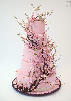 this is a cake I've always wanted. It's the cherry blossoms that get me ♥ and how they climb around the different tiers of the cake.