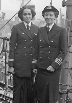 Chief Officer Margaret L Cooper, Deputy Director of the Women's Royal Indian Naval Service (WRINS), with Second Officer Kalyani Sen, WRINS at Rosyth during their two month study visit to Britain, 3rd June 1945 ~