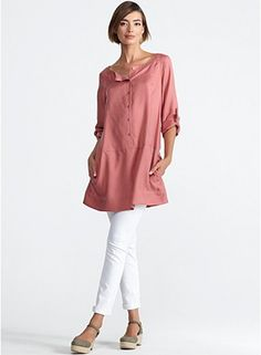 Ballet neck coral 36 inch long shirtdress in easy care sandwashed silk twill; tab sleeves with vented cuffs, side pockets; easy boxy shape with dropped waist; quietly elegant with a sinuous matte surface; for best results dry clean; 100% silk