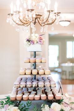 A tiered 'cake' look: http://www.stylemepretty.com/2015/03/19/the-prettiest-wedding-cupcakes-ever/