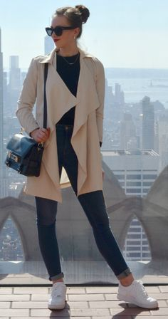 Almost nothing sleeker + black and cream combination + Barbora Ondrackova + ready to hit the streets + gorgeous floaty trench coat + simple black sweater + denim jeans + sneakers   Sweater: Proenza Schouler, Jeans: Acne, Coat: Fashionpills, Sneakers: Nike.