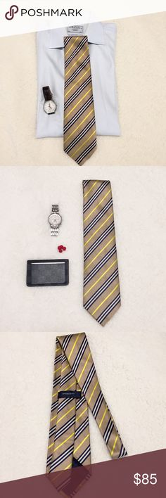 100% Authentic Burberry Silk Tie 100% Authentic Burberry Tie purchased from Nordstrom. Standard size tie (Not skinny). Worn once or twice. CONDITION: Excellent- no stains or pulls. COLORS:  yellow, tan and navy. ✨Check out my closet for another Burberry Tie I have listed!✨ Thanks!! Burberry Accessories Ties