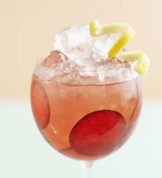 Make a Liquid Lust, a mixed punch drink of Rosangel tequila, white wine, orange and cranberry juices, club soda, and fresh citrus, grapes, and apples.