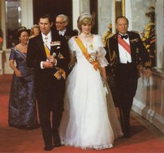 HRH Prince and Princess of Wales. Our Diana was so very young in this picture with lots still to learn about being a Royal. Even so she looked every inch a real Princess holding on to the arm of her Prince. Charles didn't look too bad either!