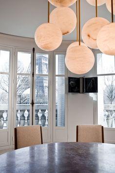 twelvedecibelstatic:  Modern Parisian Dining Room. (via A Modern Apartment Near The Eiffel Tower | Yatzer)  love the lantern inspired hanging lights