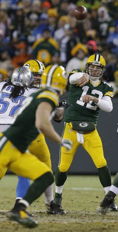 Green Bay Packers quarterback Aaron Rodgers (12) throws a pass to wide receiver Jordy Nelson. - Image credit: Mark Hoffman